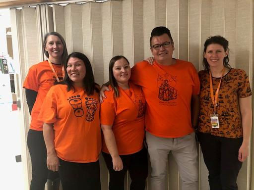 Five team members from the Royal Alexandra Hospital all wearing orange for Orange Shirt Day 2019.