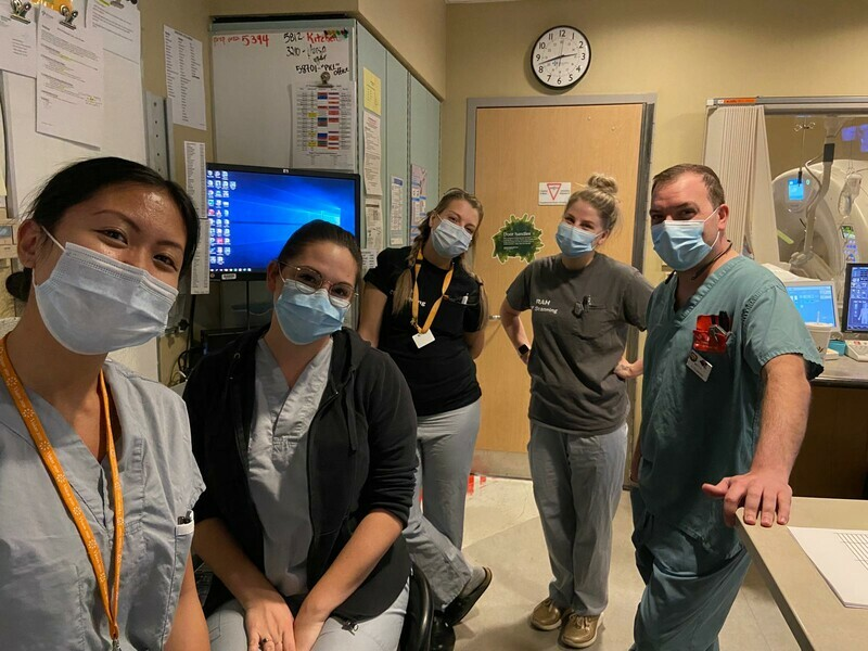 Five team members from the Diagnostic Imaging department, wearing scrubs and masks.